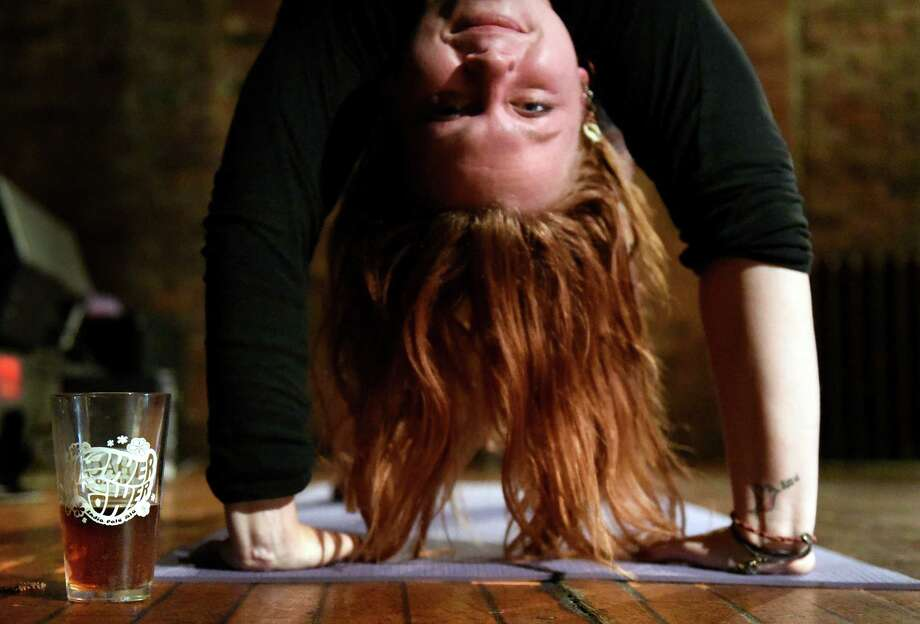 Yoga instructor Robyn Filkins leads a Yoga and Brews class on Saturday, Oct. 8, 2016, at Parish Public House in Albany, N.Y. (Cindy Schultz / Times Union) Photo: Cindy Schultz / Albany Times Union