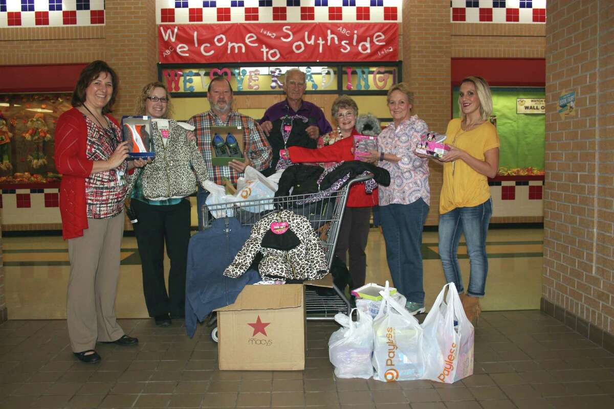 Coats, underwear, socks and shoes were delivered to Southside Primary on Thursday by members of New Hope Baptist Church of Cleveland and Martin Chevrolet. The items will go to children in need on the campus. Pictured left to right are Lori Starnes, counselor; Anna Bryant, counselor; Robert Bettis, fleet manager of Martin Chevorlet; Kenneth and Vada Syphett, mission committee members for New Hope Baptist Church; Jewel Wisiackas; and Terri Elliott Whitmire.