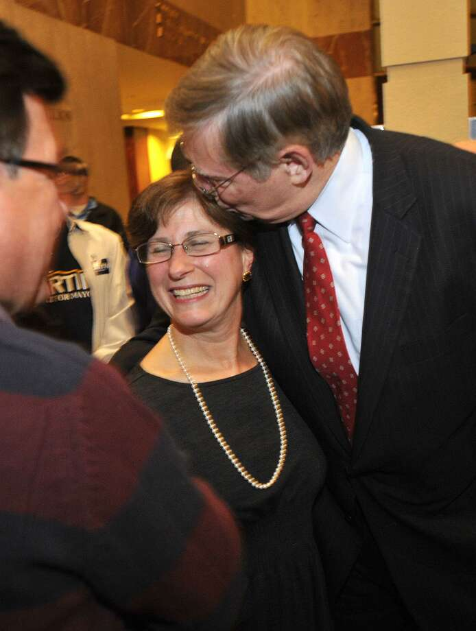 Mayor-elect David Martin kisses his wife, Judy, after entering the room on election night at the Democratic headquarters at the Stamford Mariott in Stamford, Conn., on Tuesday, Nov. 5, 2013. Photo: Jason Rearick / Jason Rearick / Stamford Advocate