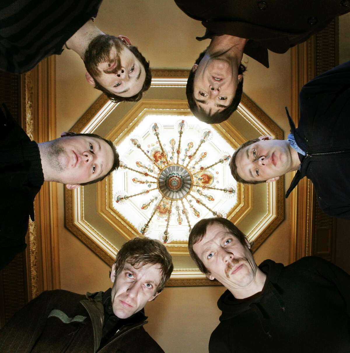 Members of Modest Mouse, clockwise from upper left, Eric Judy (with beard), Johnny Marr, Joe Plummer, Tom Peloso, Jeremiah Green and Isaac Brock pose for a photo at the Crystal Ballroom in Portland, Ore., Wednesday, March 14, 2007.(AP Photo/Don Ryan)
