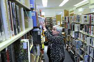 Anita Barney, director of the Brookfield Library, says that due to lack of space, book shelves at the library are much higher than optimal, Thursday, May 5, 2016