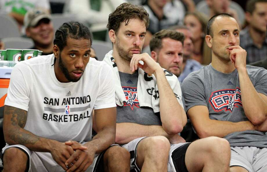 San Antonio Spurs' Kawhi Leonard (from left), Pau Gasol, and Manu Ginobili watch second half action against the Los Angeles Clippers from the bench Saturday Nov. 5, 2016 at the AT&T Center. The Clippers won 116-92. Photo: Edward A. Ornelas, Staff / San Antonio Express-News / © 2016 San Antonio Express-News
