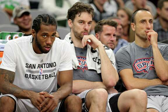 San Antonio Spurs' Kawhi Leonard (from left), Pau Gasol, and Manu Ginobili watch second half action against the Los Angeles Clippers from the bench Saturday Nov. 5, 2016 at the AT&T Center. The Clippers won 116-92.