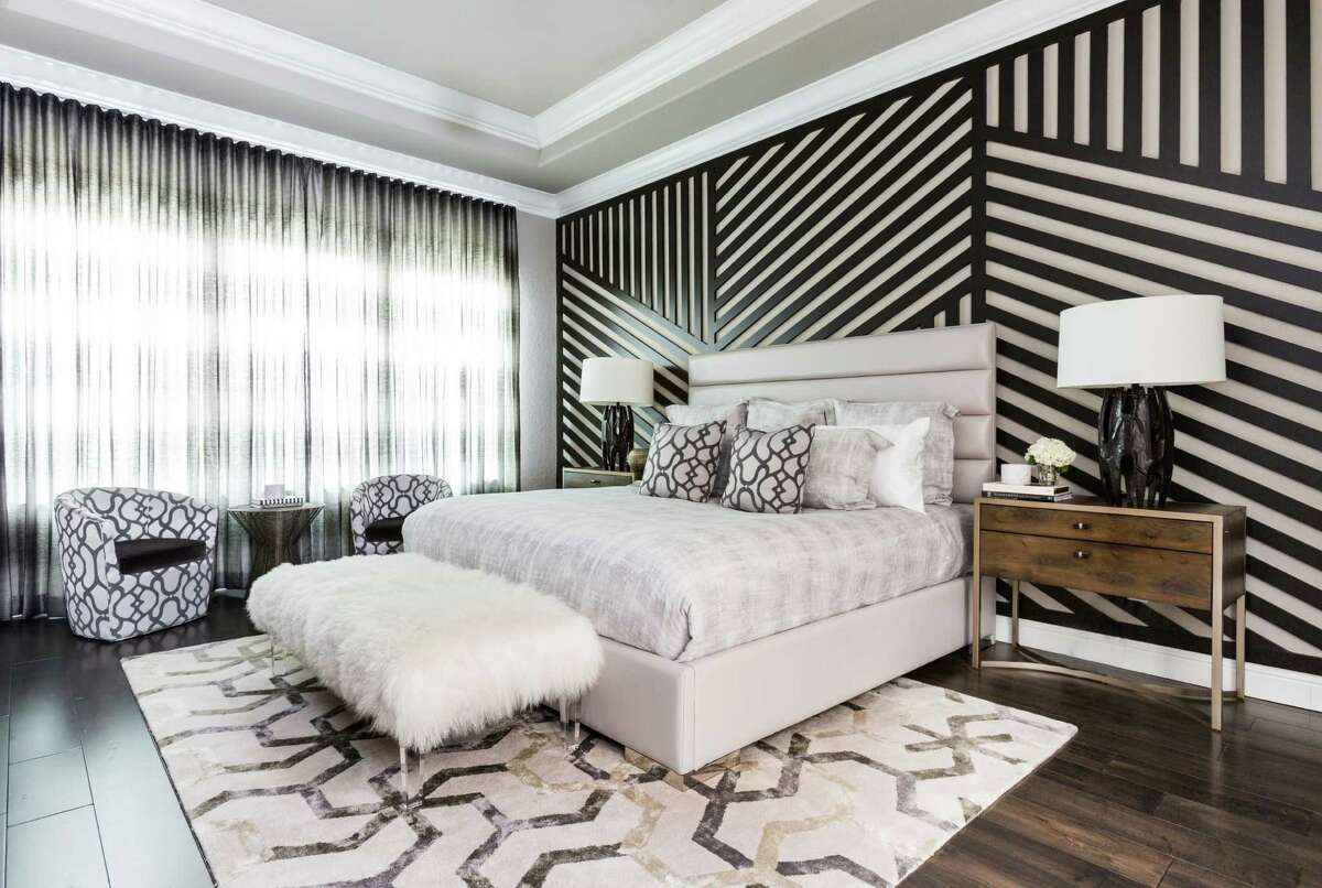 The unique wall treatment is a custom wooden design on top of painted walls.