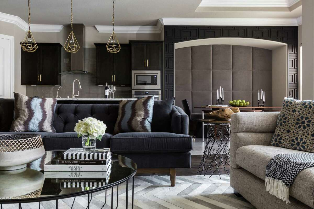 Azmina Momin's Sugar Land home is her first, and it's filled with a modern eclectic sensibility. Mixed metals are found in lighting and coffee tables, neutrals are in the furniture and rugs. And that fabulous upholstered wall in the dining area, yummy. Her designer: Nina Magon. Read more.
