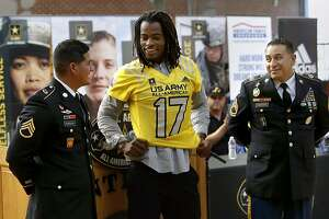 Antioch High School star running back Najee Harris is officially recognized as a U.S. Army All-American player as he is introduced by Staff Sergeant First Class Staff Sergeant Edmundo Rodriguez, (left) and  Henry Romero, during a presentation on Fri. Oct 7, 2016, in Antioch, California. The nation�s premier high school All-American game, featuring the best 90 players in an annual East vs. West will matchup in  January  2017, in San Antonio�s Alamodome.