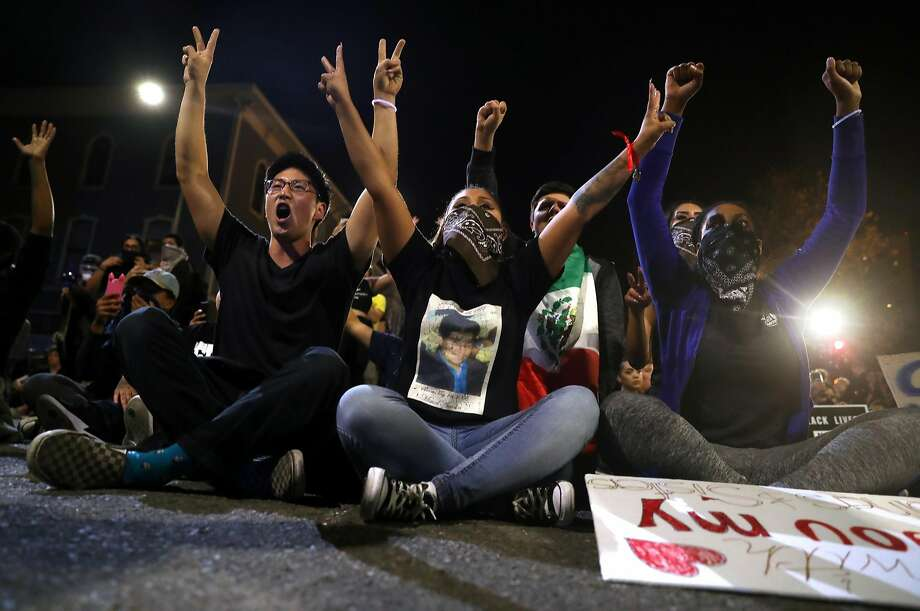 Anti Donald Trump protesters stage a sit in against the Oakland Police during a protest march in Oakland on Wednesday. Photo: Scott Strazzante, The Chronicle