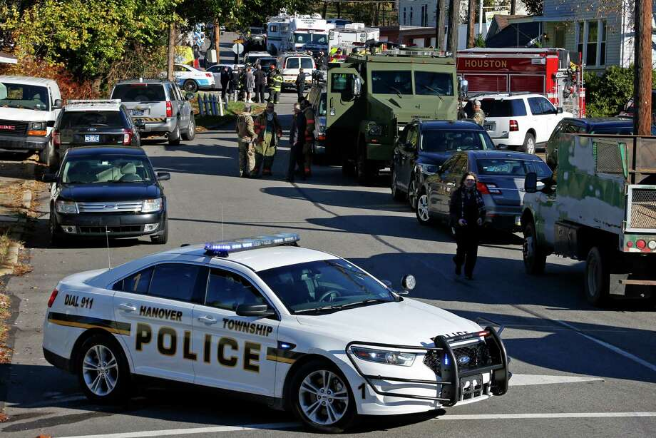 Police vehicles line streets of the Canonsburg, Pa., neighborhood where two Canonsburg police officers were shot when they responded to a domestic call early in Canonsburg, Pa., Thursday, Nov. 10, 2016. (AP Photo/Gene J. Puskar) Photo: Gene J. Puskar, STF / Copyright 2016 The Associated Press. All rights reserved.