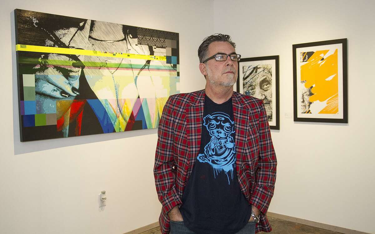 Robert Tatum stands in his new gallery, Show Down Gallery, in the Blue Star Arts Complex.