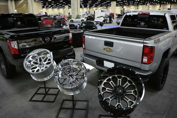 Bells and whistles for pickups are on display at the San Antonio Auto & Truck Show at the Convention Center. Here, Tim Duncan's BlackJack Speed Shop displays some of its wares.