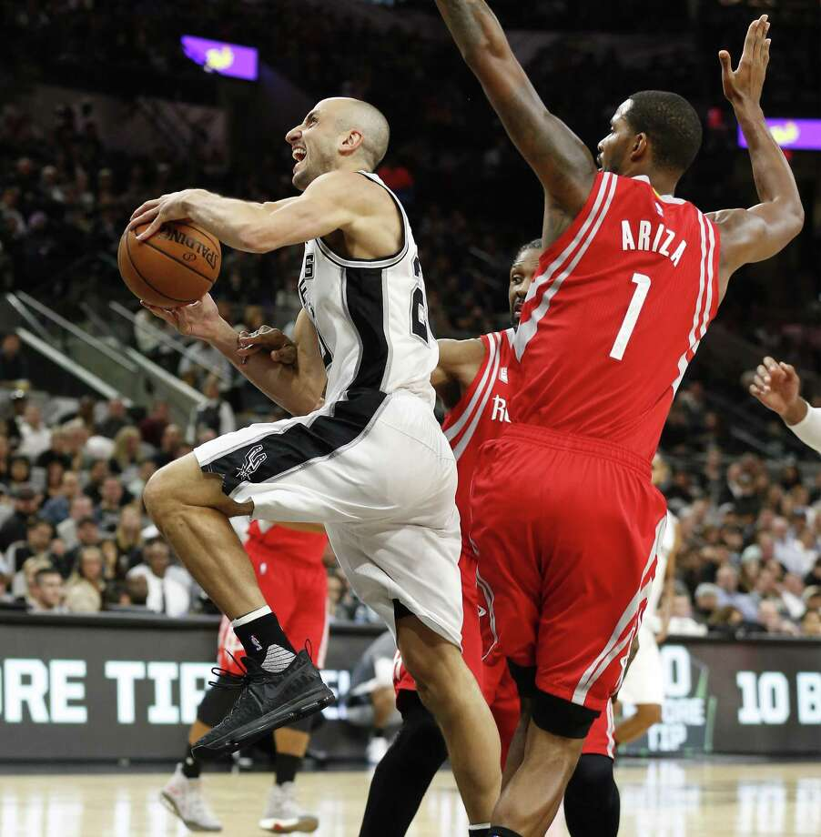 Spurs' Manu Ginobili gets fouled by the Houston Rockets' Trevor Ariza at the AT&T Center on Nov. 9, 2016. Photo: Kin Man Hui /San Antonio Express-News / ©2016 San Antonio Express-News