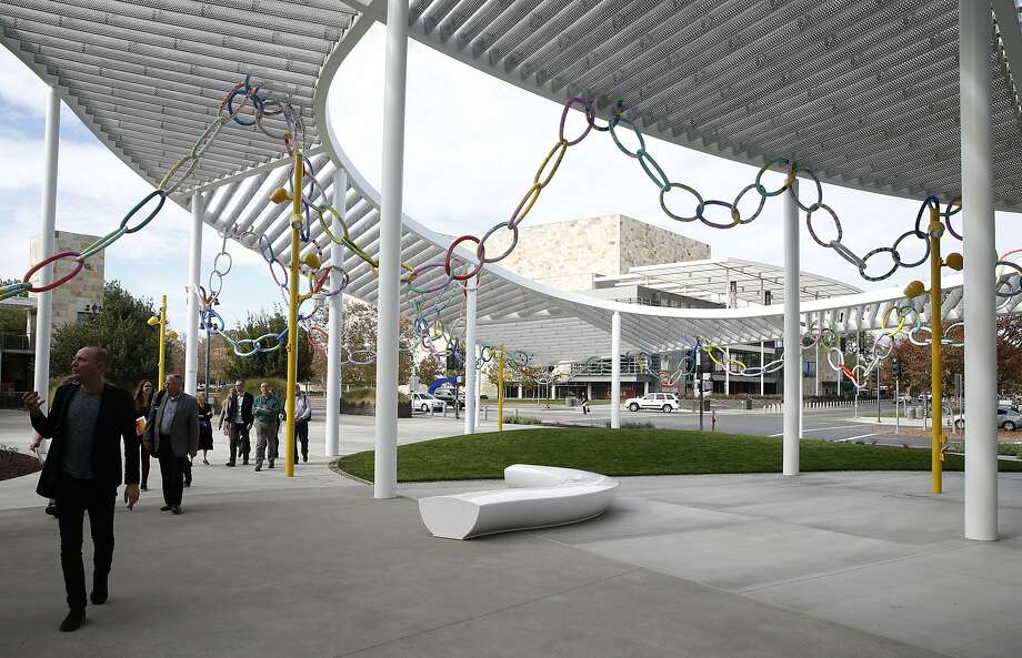 A ribbon of foam links by artist Lisa Rybovich Crallé is woven through horizontal aluminum beams on the grand canopy above the main plaza of the Jan Shrem and Maria Manetti Shrem Museum of Art at UC Davis. Photo: Paul Chinn, The Chronicle