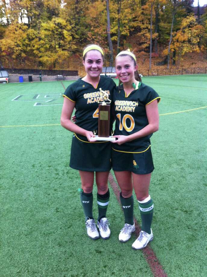 Greenwich Academy senior captains Whitney Balanoff, left, and Anna Khoury, hold the championship trophy after Greenwich Academy won its 33rd straight FAA field hockey championship on Thursday, Nov. 10, 2016 with a 4-1 victory over Sacred Heart. Photo: David Fierro / Hearst Connecticut Media / Contributed Photo / Greenwich Time Contributed