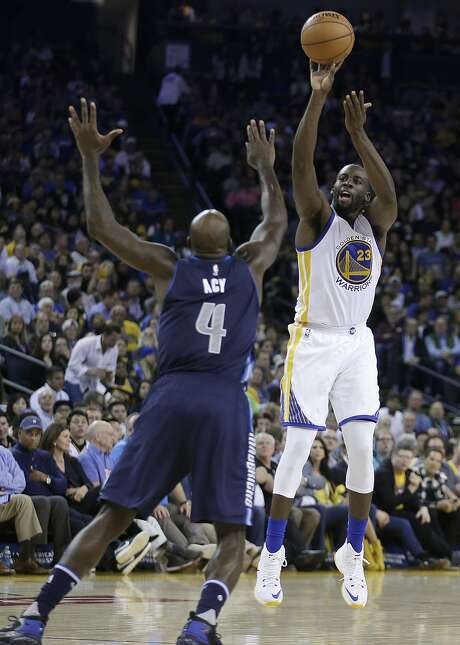 Golden State Warriors' Draymond Green, right, shoots against Dallas Mavericks' Quincy Acy during the second half of an NBA basketball game Wednesday, Nov. 9, 2016, in Oakland, Calif. (AP Photo/Ben Margot) Photo: Ben Margot, Associated Press