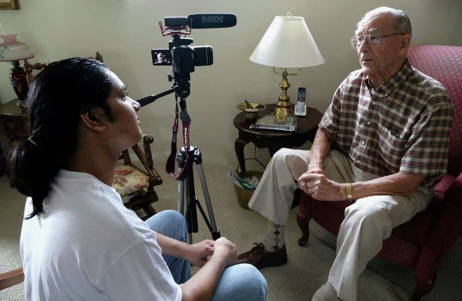 Rishi Sharma interviews World War II veteran William R. Hahn on Oct. 17 at his home in Los Angeles. Sharma's heroes aren't sports or movie stars; rather, they are the U.S. combat veterans who won World War II. Photo: Nick Ut, STF / Copyright 2016 The Associated Press. All rights reserved.