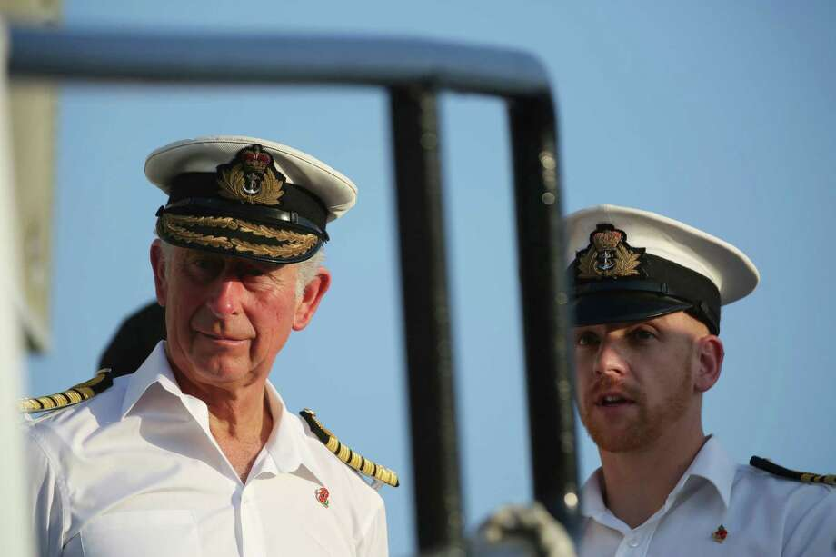 Prince Charles stands aboard the HMS Middleton docked at Britain's Mina Salman Support Facility in Manama, Bahrain, on Thursday, Nov. 10, 2016. Prince Charles and his wife Camilla are touring Bahrain but their visit come amid criticism of the island nation conducting a fierce crackdown on dissent. (AP Photo/Jon Gambrell) Photo: Jon Gambrell, STF / Copyright 2016 The Associated Press. All rights reserved.