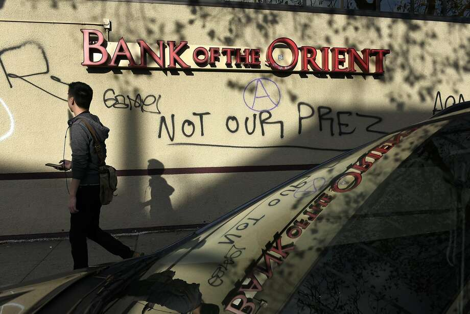 Protests of the election took many forms in the Bay Area, such as this graffiti sprayed on an Oakland bank. Photo: Michael Short, Special To The Chronicle