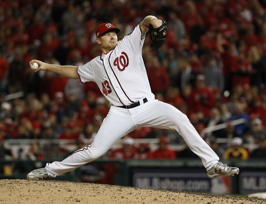Washington Nationals relief pitcher Mark Melancon throws to a Los Angeles Dodgers batter during the eighth inning of Game 5 of a baseball National League Division Series, at Nationals Park on Thursday, Oct. 13, 2016, in Washington. Photo: Pablo Martinez Monsivais, Associated Press