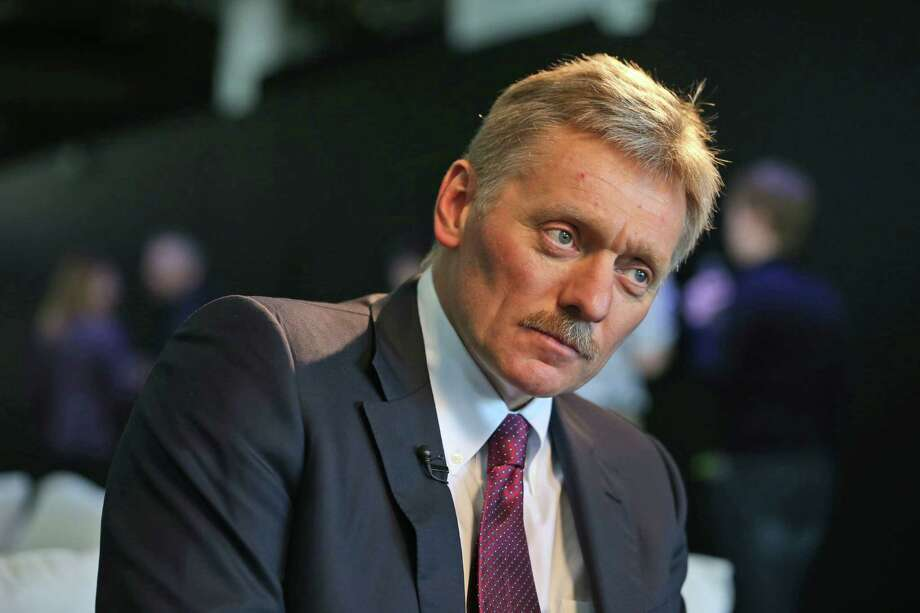 Kremlin press secretary Dmitry Peskov talks to a reporter in New York, Thursday, Nov. 10, 2016. In careful phrasing befitting the spy he once was, Vladimir Putin has made it clear he expects a great deal from President-elect Donald Trump. And, the billionaire businessman may expect a transactional relationship with Putin. (AP Photo/Seth Wenig) Photo: Seth Wenig, STF / AP