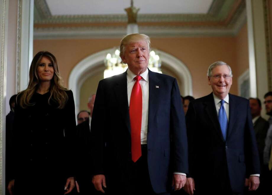 President-elect Donald Trump and his wife Melania walk with Senate Majority Leader Mitch McConnell of Kentucky on Capitol Hill after a meeting Thursday. Photo: Alex Brandon, STF / Copyright 2016 The Associated Press. All rights reserved.