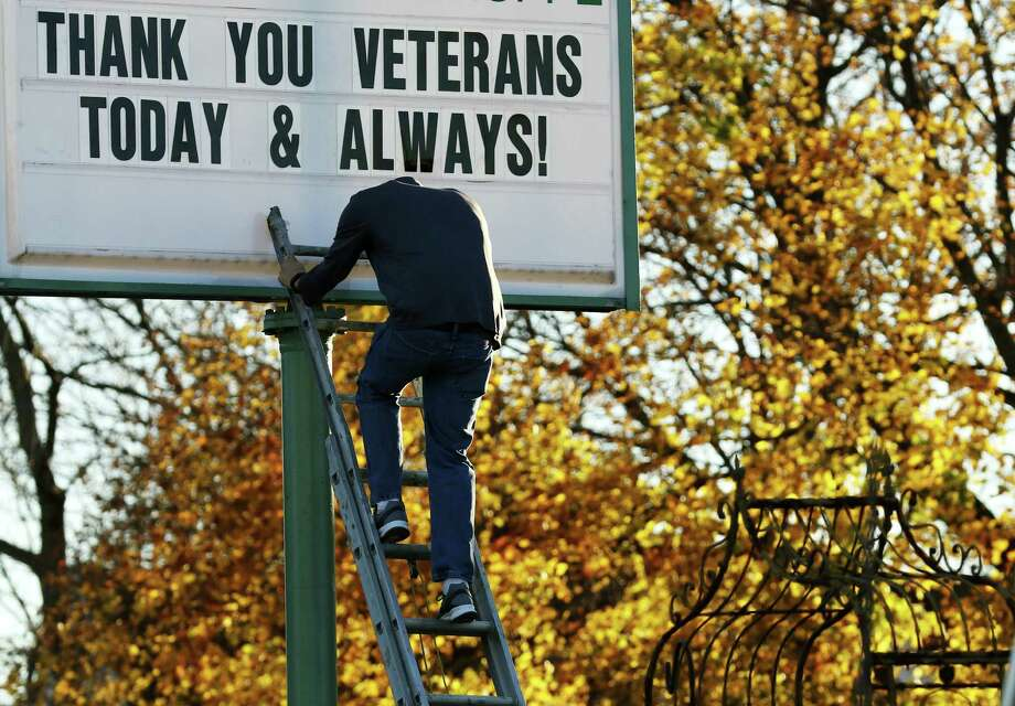On this Veterans Day, it's important we all remember that, despite what we've heard during the campaign that's now mercifully over, we can take extraordinary pride in the men and women doing the noble duty of defending our country. (John Ehlke / West Bend Daily News via AP) Photo: John Ehlke, MBR / West Bend Daily News
