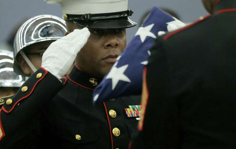 Marine Sgt. Leonardo Bryant salutes the flag during the Old Glory Ceremony as part a Veteran's Day service at the Michael E. DeBakey VA Medical Center Thursday. See Veterans Day closings on page A8.  Photo: Elizabeth Conley, Staff / © 2016 Houston Chronicle