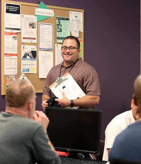 Community health worker Joseph Calderon gives a motivation talk at LCA Services' Community Assessment and Services Center in San Francisco. Photo: Liz Hafalia, The Chronicle