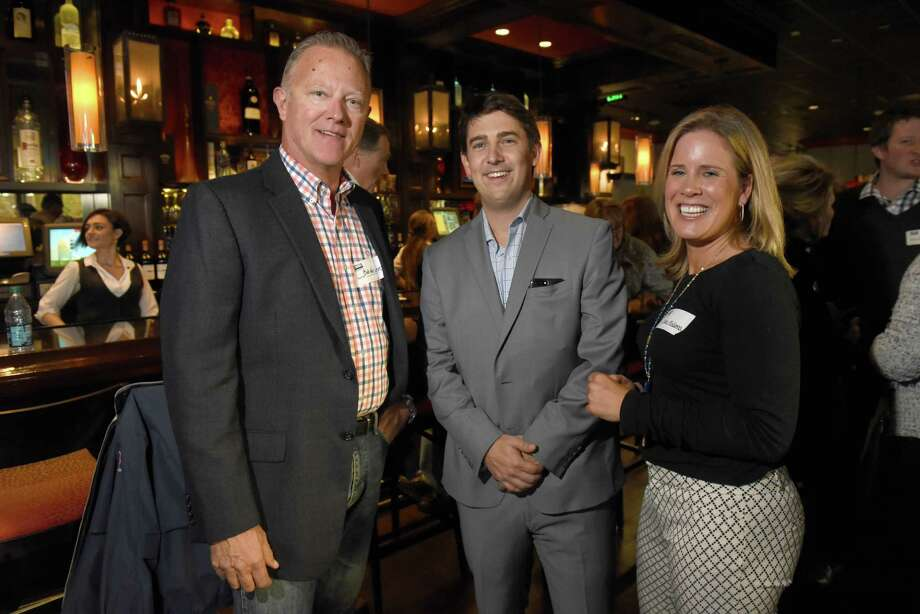 Air Force veteran & Bethlehem cop Bob Helligrass, left, Coldwell Banker Prime Properties general manager RJ Long, center, and recruiter Jane McKenna during a mixer at Delmonico's on Thursday Nov. 3, 2016 in Clifton Park, N.Y. Coldwell Banker Prime Properties has launched a program to bring veterans and their spouses into the real estate biz. CBPP is paying for licensing classes, the exam fee and membership in the local MLS. In return, the company expects a 2-year commitment. (Michael P. Farrell/Times Union) Photo: Michael P. Farrell / 20038585A