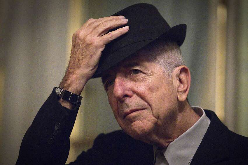 Leonard Cohen takes off his hat to salute in Paris.