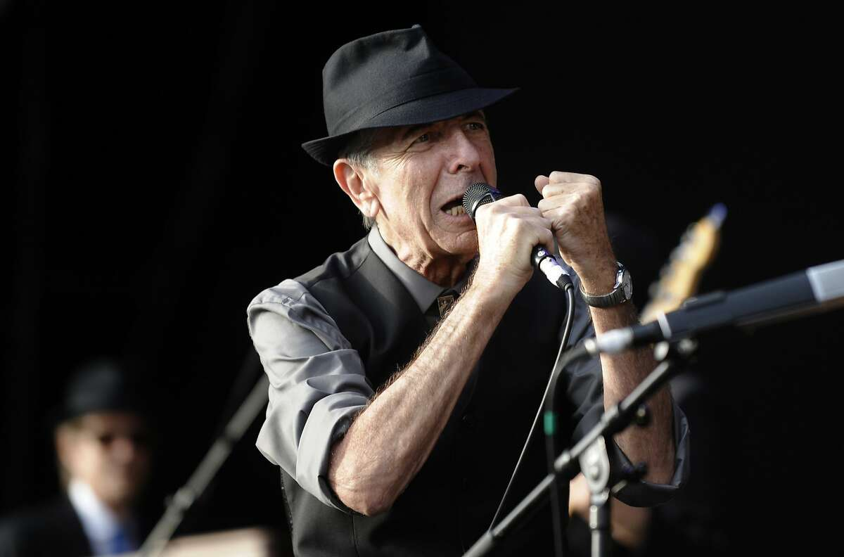 (FILES) This file photo taken on July 20, 2008 shows Canadian singer Leonard Cohen perform during the international Festival of Beincassim. Leonard Cohen, the storied musician and poet hailed as one of the most visionary artists of his generation, has died at age 82, his publicist announced on November 10, 2016. / AFP PHOTO / Diego TUSONDIEGO TUSON/AFP/Getty Images