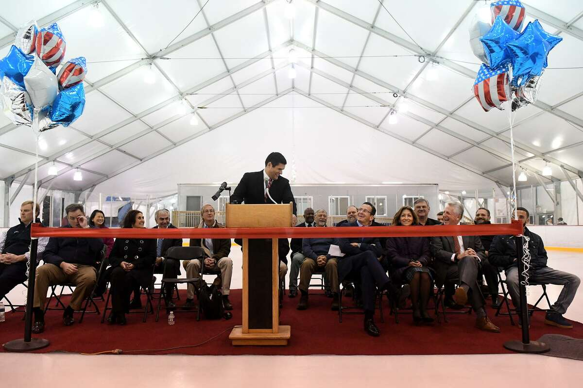 SONO Ice House Founder and Managing Partner Ryan Hughes entertains his audience including Governor Dannel Malloy, Norwalk Mayor Harry Rilling during a ceremony celebrating the launch of the Rinks at Veterans Park in Norwalk, Conn., Nov. 10, 2016. The site features two seasonal double surface regulation ice rinks, covered in a removable structure, the first of their kind ever built.