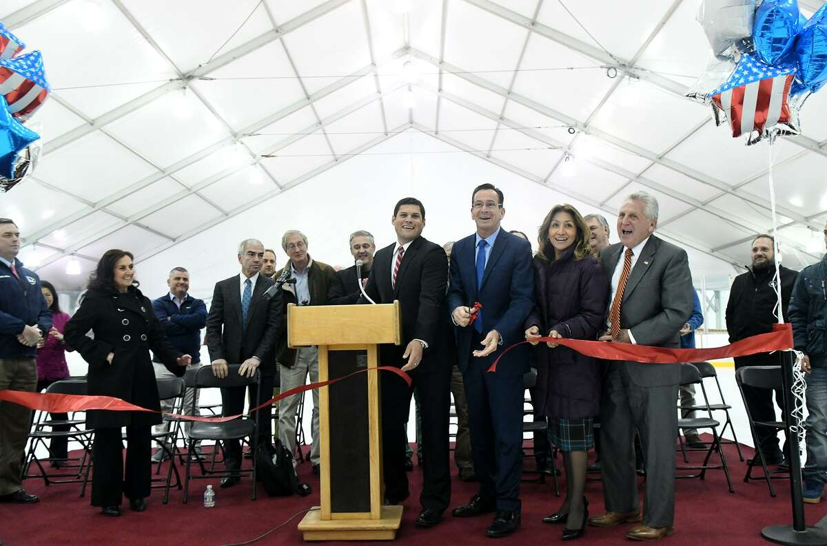 SONO Ice House Founder and Managing Partner Ryan Hughes, Governor Dannel Malloy, Lucia Rilling and Norwalk Mayor Harry Rilling cut the ribbon celebrating the launch of the Rinks at Veterans Park in Norwalk, Conn., Nov. 10, 2016. The site features two seasonal double surface regulation ice rinks, covered in a removable structure, the first of their kind ever built.
