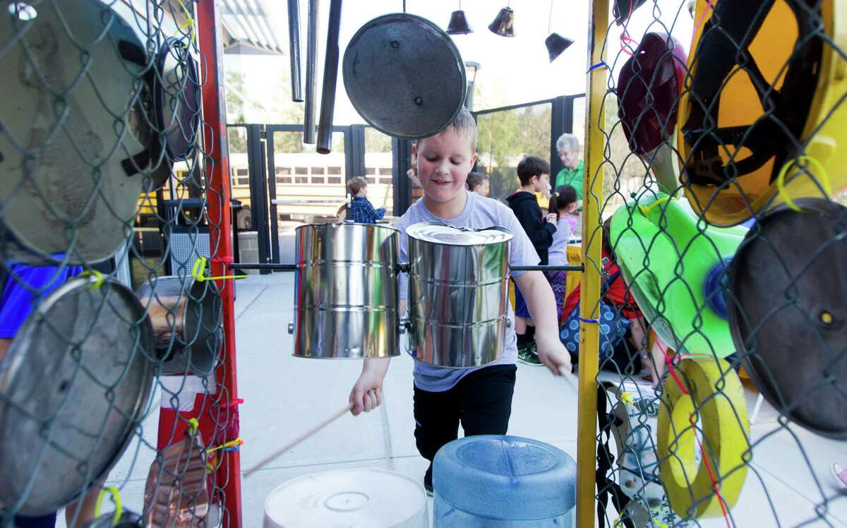 A student bangs away at can lids and buckets during the annual Children's Festival at the Cynthia Woods Mitchell Pavilion Thursday, Nov. 10, 2016, in The Woodlands.