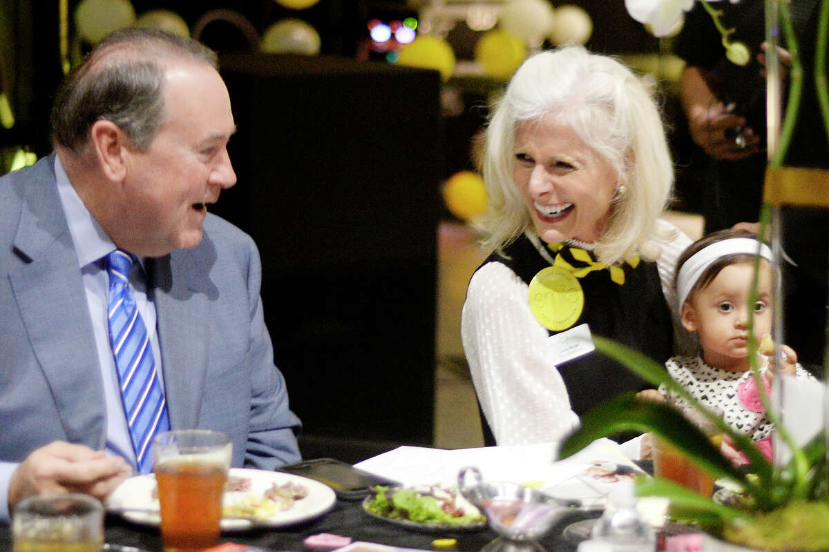 Mike Huckabee, 44th Governor of Arkansas, visits with Judy Rouse, executive director of the Life Center of Midland and 11-month old Zoelyn Johnston during the Life Center Fall Fundraiser on Thursday, Nov. 10, 2016, at Horseshoe Pavilion. James Durbin/Reporter-Telegram