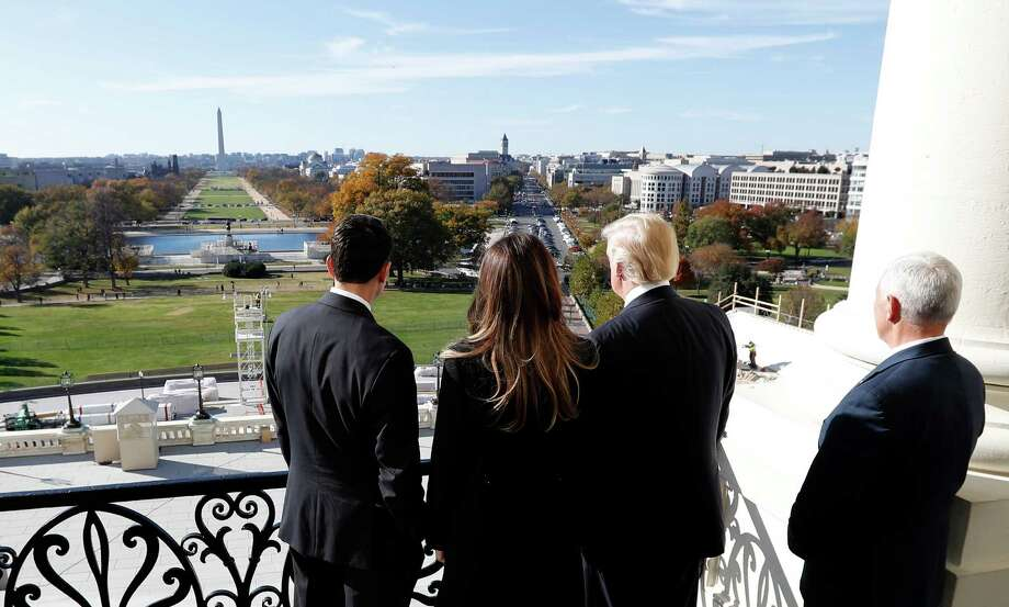 Speaker Paul Ryan, left, shows President-elect Donald Trump, his wife, Melania, and Vice President-elect Mike Pence the view of the inaugural stand that is being built, from his office on Capitol Hill. Photo: Alex Brandon, STF / Copyright 2016 The Associated Press. All rights reserved.