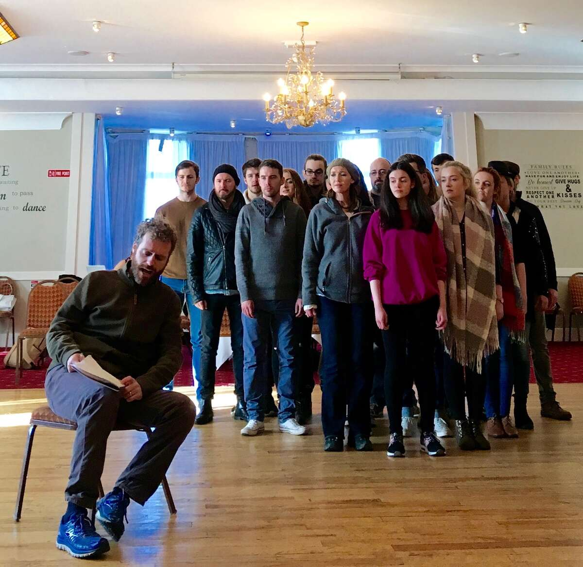 Andrew Holden, front, rehearsing with the cast of