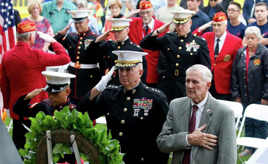 Marines salute during a celebration in honor of the U.S. Marine Corps' 241st birthday at Town Green Park Thursday, Nov. 10, 2016, in The Woodlands. Photo: Jason Fochtman, Staff Photographer / Houston Chronicle