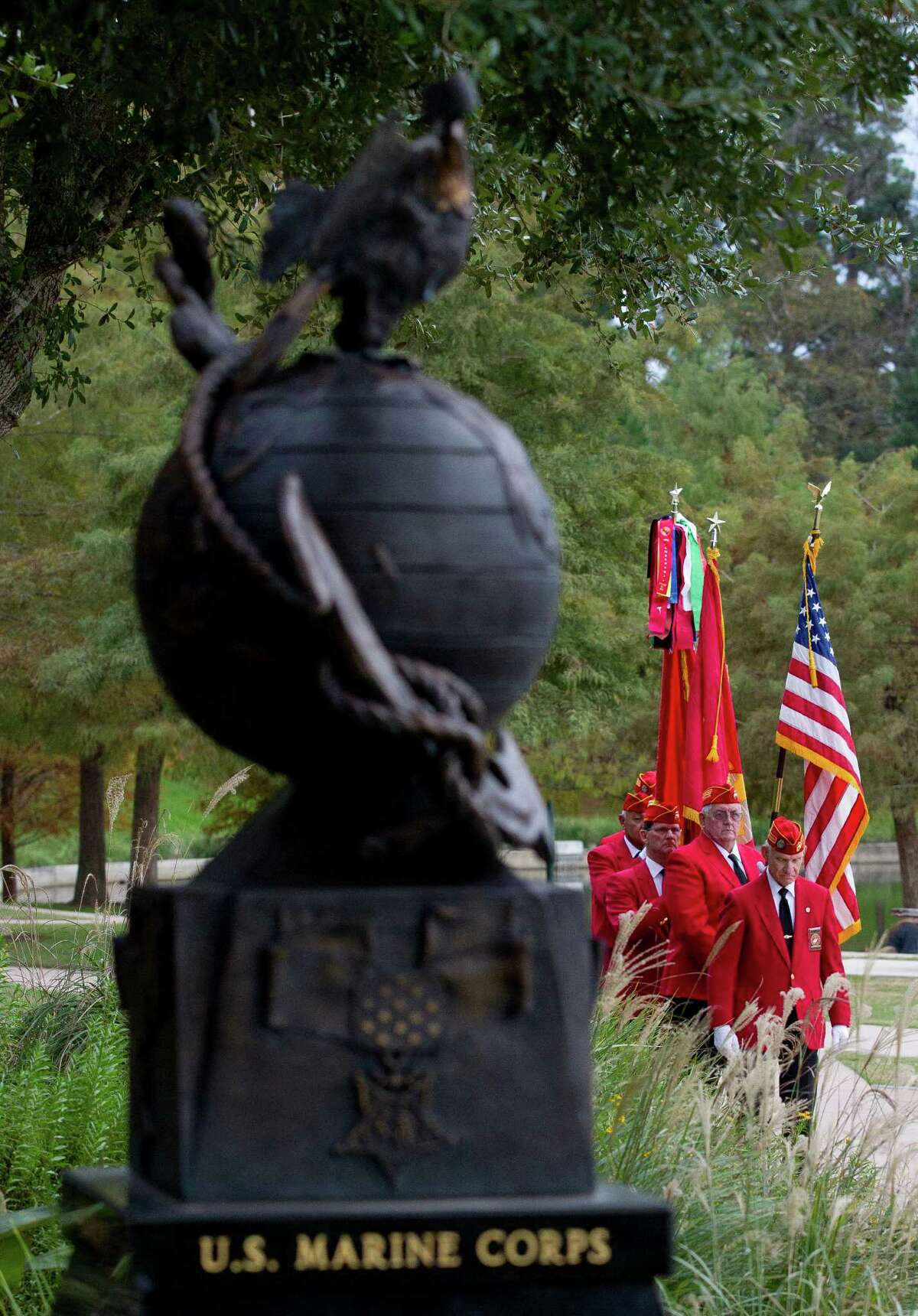 Marine Corps League members march in to present the colors during a celebration in honor of the U.S. Marine Corps' 241st birthday at Town Green Park Thursday, Nov. 10, 2016, in The Woodlands.