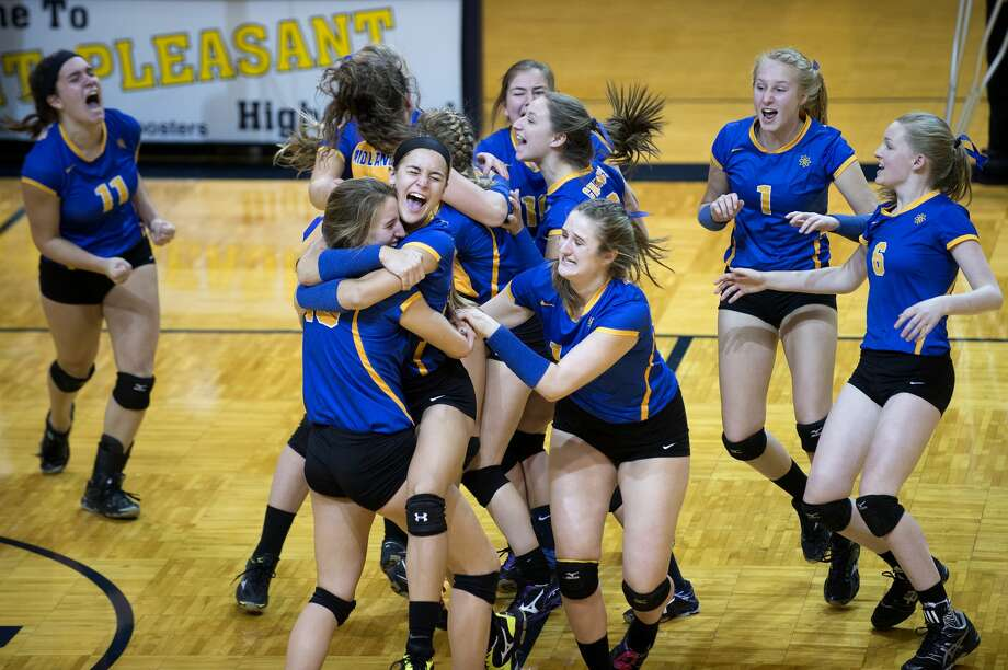 The Midland High girls volleyball team celebrates winning Class A regional volleyball championship match against Davison High Thursday evening at Mount Pleasant High School. The Chemics defeated Davison 21-25, 25-18, 25-21, 20-25, 15-13. Midland will play in the MHSAA quarterfinal match at H.H. Dow High School Nov. 15 at 6 p.m. Photo: Brittney Lohmiller/Midland Daily News/Brittney Lohmiller