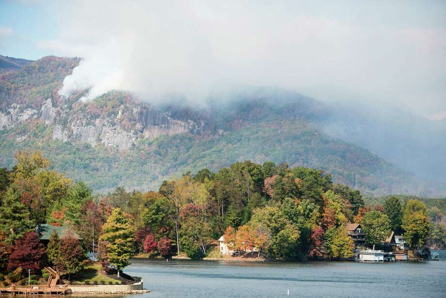 Smoke from the Party Rock fire near Lake Lure spreads as emergency services and the N.C. Forest Service work to contain the blaze Wednesday Nov. 9, 2016 at Lake Lure, N.C.  Unseasonably warm dry weather has deepened a drought that's igniting forest fires across the southeastern U.S.   (Abigail Margulis/The Asheville Citizen-Times via AP) ORG XMIT: NCASH103 Photo: Abigail Margulis / The Asheville Citizen-Times