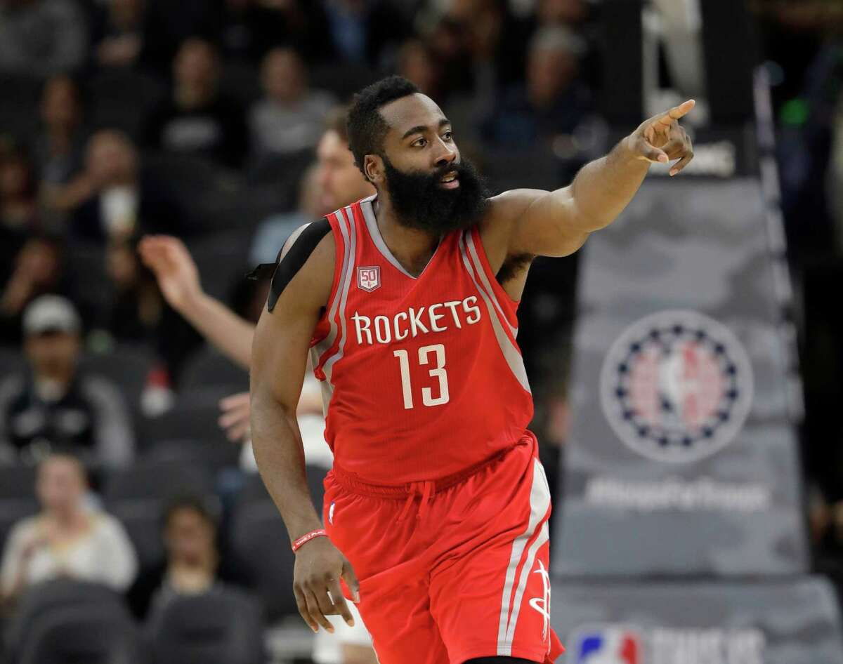 Houston Rockets guard James Harden signals to a teammate during the second half of the Rockets' NBA basketball game against the San Antonio Spurs, Wednesday, Nov. 9, 2016, in San Antonio. Houston won 101-99. (AP Photo/Eric Gay)