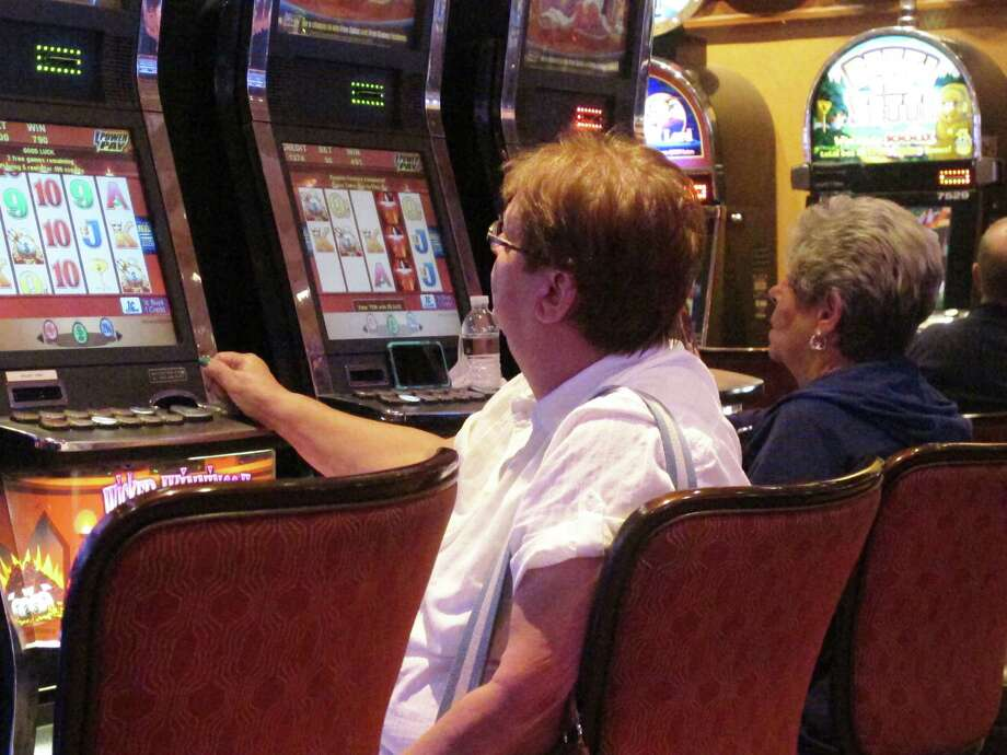 A gambler plays slot machines at the Golden Nugget casino in Atlantic City, N.J.  Photo: Wayne Parry, STF / Copyright 2016 The Associated Press. All rights reserved.