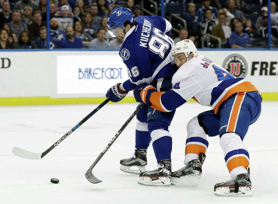 Tampa Bay Lightning right wing Nikita Kucherov (86), of Russia, gets held by New York Islanders defenseman Calvin de Haan as he goes in on a breakaway on Islanders goalie Thomas Greiss, of Germany, during the second period of an NHL hockey game Thursday, Nov. 10, 2016, in Tampa, Fla. (AP Photo/Chris O'Meara) ORG XMIT: TPA109 Photo: Chris O'Meara / Copyright 2016 The Associated Press. All rights reserved.