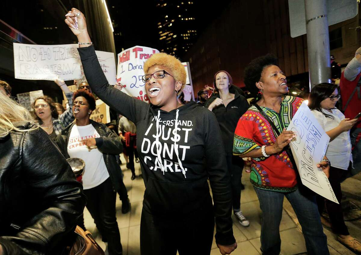 UH senior Kaylin Richard shouts during a Houston protest on Thursday against the election of Donald Trump.