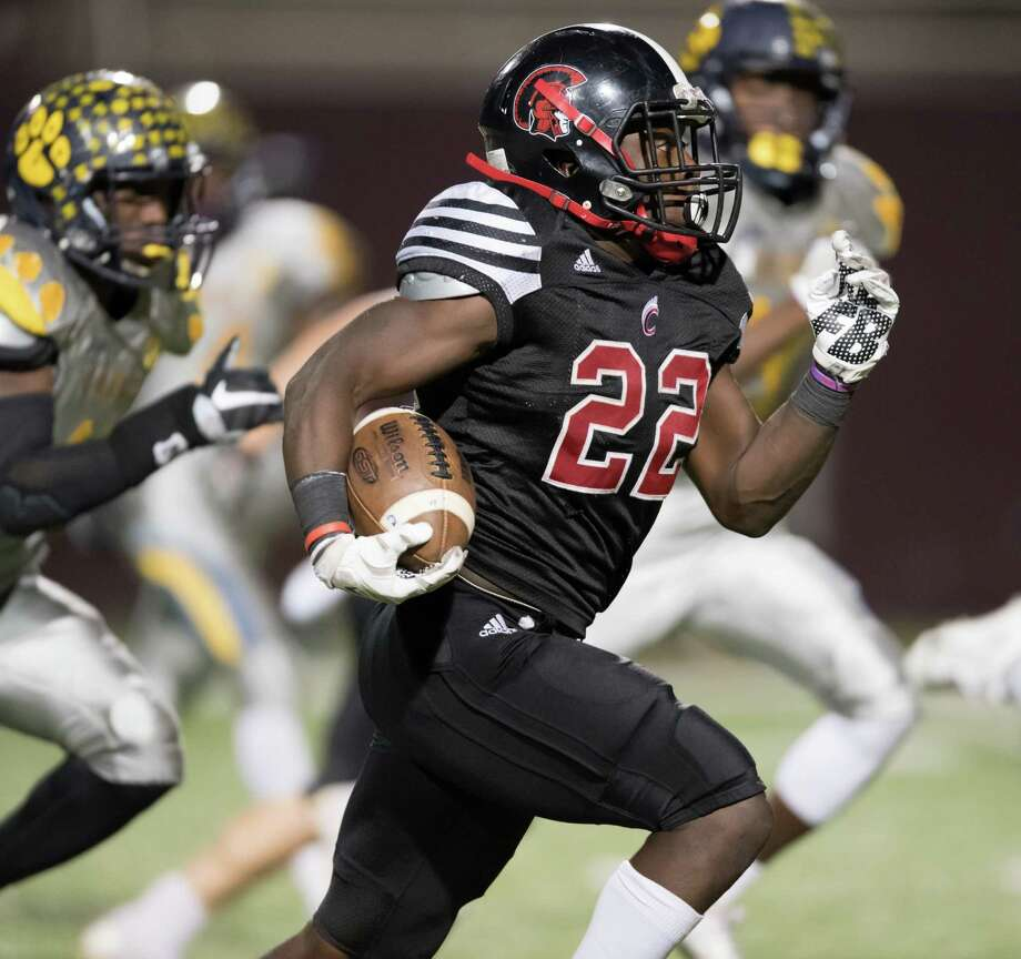 Coldspring-Oakhurst running back Don Taylor scores one of his four rushing touchdowns against La Marque. Photo: Wilf Thorne / © 2016 Houston Chronicle