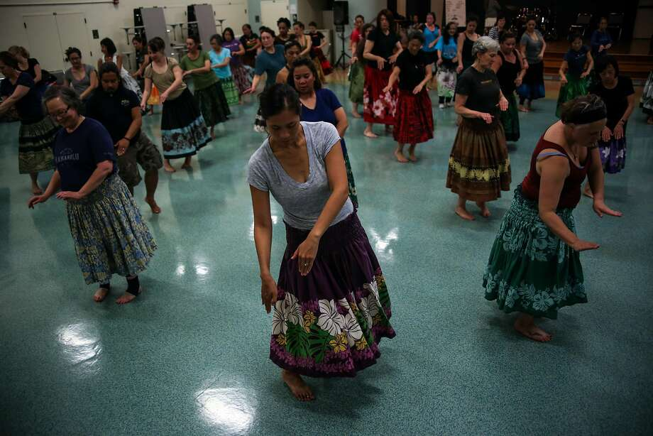 Andrea Ramirez practices moves during a Na Lei Hulu I Ka Wekiu hula dance class in San Francisco. Photo: Joel Angel Juarez, Special To The Chronicle