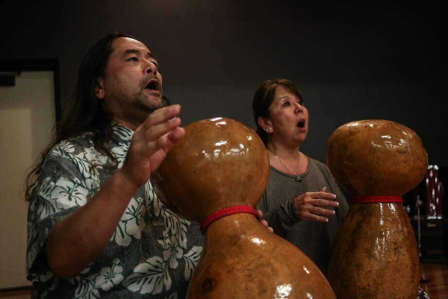 John Shima (left) and Debbie Garcia play the ipu heke during a Na Lei Hulu I Ka Wekiu hula class. Photo: Joel Angel Juarez, Special To The Chronicle