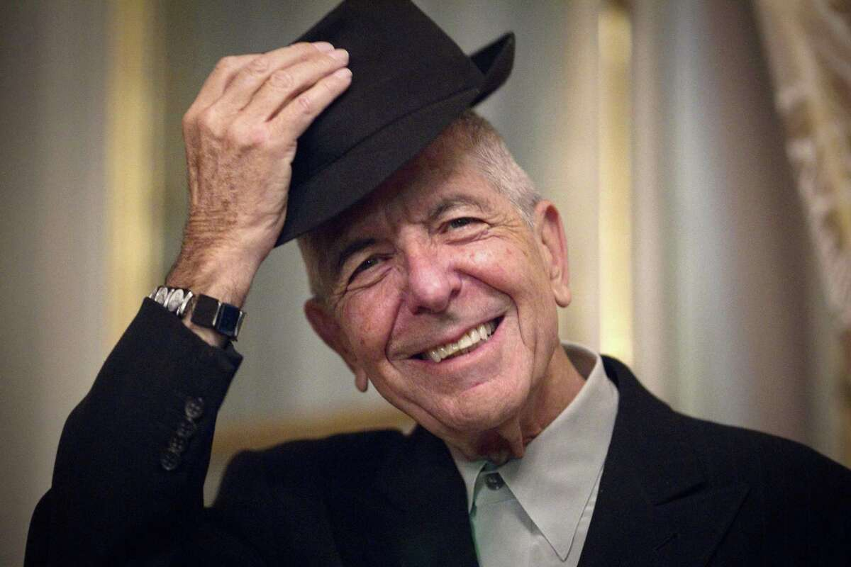 (FILES) This file photo taken on January 16, 2012 shows Canadian singer and poet Leonard Cohen taking off his hat to salute in Paris. Leonard Cohen, one of his generation's most respected musicians and poets who delved into the spiritual on songs such as