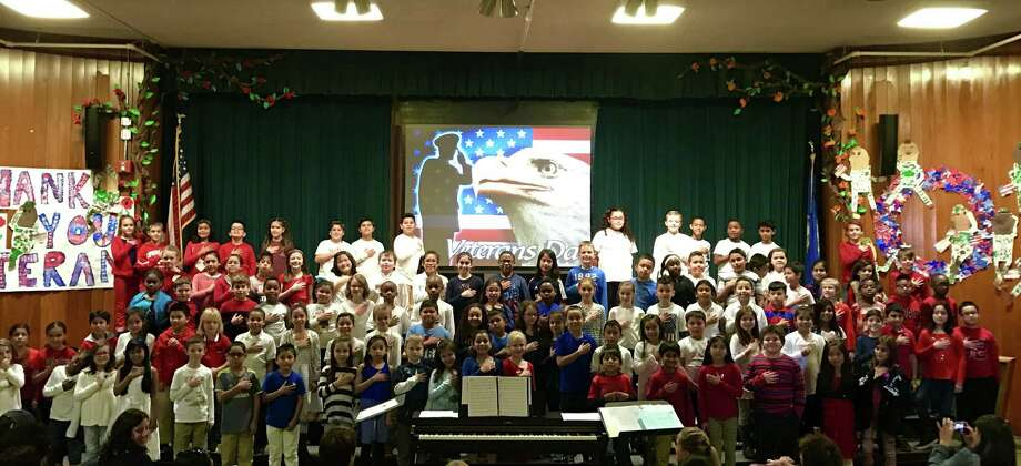 "The third-grade class at Stark Elementary School sings during a choral performance, ""Tribute to Veterans,"" on Thursday morning. Photo: Contributed"
