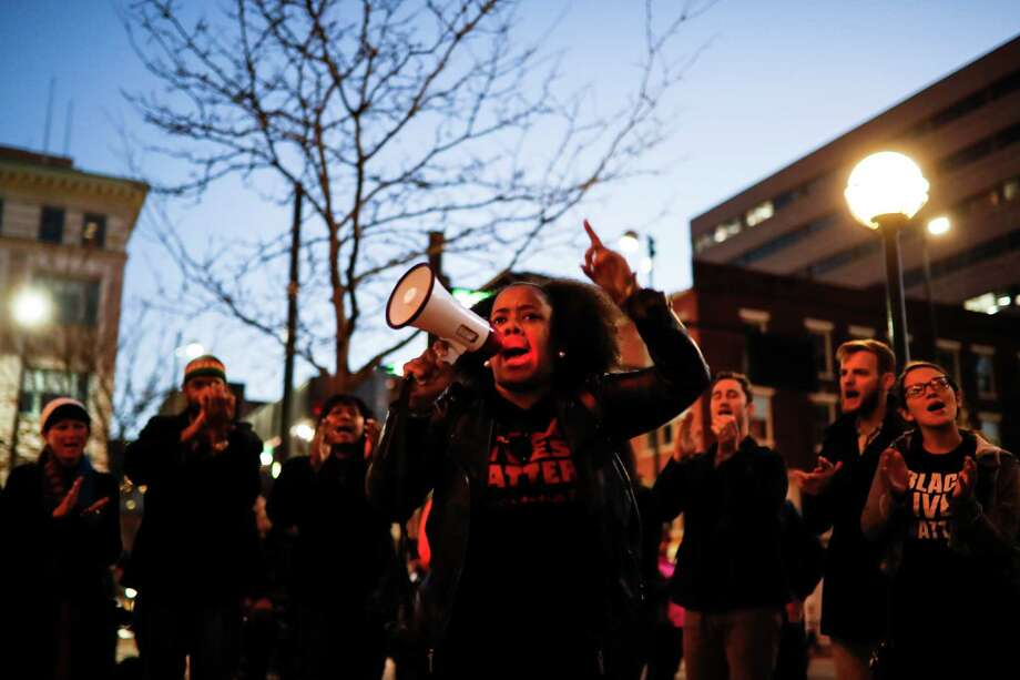 Christina Brown leads a chant as demonstrators protest outside Hamilton County Courthouse on the second day of jury deliberations in Ray Tensing's murder trial, Thursday, Nov. 10, 2016, in Cincinnati. The former University of Cincinnati police officer is charged with murdering Sam DuBose while on duty during a routine traffic stop on July 19, 2015. Photo: John Minchillo, AP / AP
